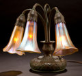 Art Glass:Tiffany , TIFFANY STUDIOS BRONZE AND FAVRILE GLASS THREE-LIGHT LILYTABLE LAMP . Three-light bronze base with gold Favrile... (Total: 4Items)