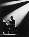 Photographs:20th Century, HERMAN LEONARD (American, 1923-2010). Duke Ellington, Paris,1958. Gelatin silver, printed later. 12-1/2 x 10 inches (31...