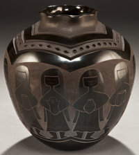 A SANTA CLARA/NAVAJO ETCHED AND CARVED BLACKWARE JAR Harrison Begay and Jody Naranjo c. 2004
