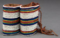 American Indian Art:Beadwork and Quillwork, A PAIR OF BLACKFEET BEADED HIDE HAIR WRAPS...