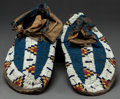 American Indian Art:Beadwork and Quillwork, A PAIR OF SIOUX BEADED HIDE MOCCASINS. c. 1900...