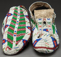 American Indian Art:Beadwork and Quillwork, A PAIR OF SIOUX BEADED HIDE CEREMONIAL MOCCASINS. c. 1900...