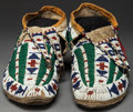 American Indian Art:Beadwork and Quillwork, A PAIR OF SIOUX BEADED HIDE MOCCASINS. c. 1890 ...