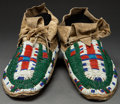 American Indian Art:Beadwork and Quillwork, A PAIR OF SIOUX BEADED HIDE MOCCASINS. c. 1905...