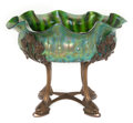 Art Glass:Other , AUSTRIAN GLASS AND METAL CENTERPIECE . Green iridescent ruffledglass bowl with original four-footed foliate metal stand, ci...