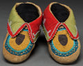 American Indian Art:Beadwork and Quillwork, A PAIR OF DELAWARE CHILD'S BEADED HIDE MOCCASINS. c. 1890...
