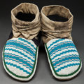 American Indian Art:Beadwork and Quillwork, A PAIR OF PLAINS CREE BEADED HIDE MOCCASINS. c. 1890...