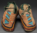 American Indian Art:Beadwork and Quillwork, A PAIR OF SIOUX BEADED HIDE MOCCASINS . c. 1890...