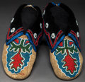 American Indian Art:Beadwork and Quillwork, A PAIR OF DELAWARE BEADED HIDE MOCCASINS. c. 1910...