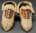 American Indian Art:Beadwork and Quillwork, A PAIR OF CREE CLOTH AND HIDE MOCCASINS...