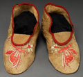 American Indian Art:Beadwork and Quillwork, A PAIR OF SANTEE SIOUX PICTORIAL QUILLED HIDE MOCCASINS...