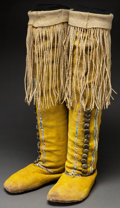 American Indian Art:Beadwork and Quillwork, A PAIR OF COMANCHE WOMAN'S BEADED AND FRINGED HIDE BOOT MOCCASINS.c. 1900...