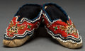 American Indian Art:Beadwork and Quillwork, A PAIR OF MICMAC CHILD'S BEADED HIDE MOCCASINS...