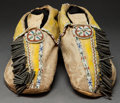 American Indian Art:Beadwork and Quillwork, A PAIR OF COMANCHE BEADED HIDE MOCCASINS. c. 1880...