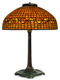 Art Glass:Tiffany , TIFFANY STUDIOS LEMON LEAF BORDER TABLE LAMP . Bronze lampbase with orange and yellow glass domed shade in a le...