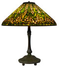 Art Glass:Tiffany , TIFFANY STUDIOS ARROWROOT TABLE LAMP. Bronze lamp base withyellow and green leaded glass shade in an arrowroot ...