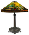 Glass, TIFFANY STUDIOS RED-EYE DRAGONFLY TABLE LAMP. Bronze lamp base with green, yellow, red and black leaded glass sh...