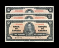 Canadian Currency: , BC-22b $2 1937. Three Examples. VF; AU; CU.. From The HaltonLake Collection... (Total: 3 notes)