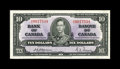 Canadian Currency: , BC-24a $10 1937.. Handling is concentrated in the center of the note. Extremely Fine-About Uncirculated.. From The Hal...