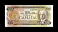 Canadian Currency: , BC-52aA-1 $100 1975.. Embossing and a corner fold are observed onthis Choice About Uncirculated replacement.. From Th...