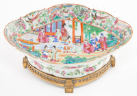 A CHINESE FAMILLE ROSE PORCELAIN BOWL WITH GILT BRONZE MOUNTS The porcelain: Jin