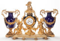 A VINCENTI ET CIE FRENCH SÈVRES-STYLE PORCELAIN AND GILT BRONZE MANTEL CLOCK AND PAIR OF COBALT PORCELAIN AND GIL...