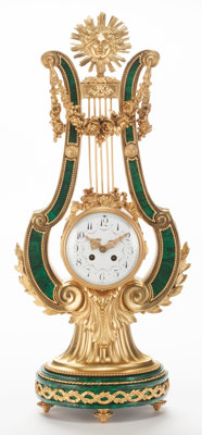 A FRENCH LOUIS XVI-STYLE MALACHITE AND GILT BRONZE LYRE-FORM CLOCK Maker unknown, France, circa 1880 27-1/2 in