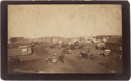 "Photography:Cabinet Photos, Two Guthrie, Oklahoma Land Run Albumen Photographs: ""Oklahoma Ave""and Parade in Guthrie.... (Total: 2 Items)"