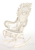 Furniture , AN AMERICAN PAINTED WICKER ROCKING CHAIR IN THE MANNER OF HEYWOOD BROTHERS & WAKEFIELD COMPANY . Circa 1900. 43 x 26-1/2 x ...