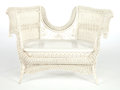 Furniture , AN AMERICAN PAINTED WICKER LOVE SEAT IN THE MANNER OF HEYWOOD BROTHERS & WAKEFIELD COMPANY . Circa 1900. 32-1/2 x 47-1/2 x...