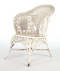 Furniture , AN AMERICAN PAINTED WICKER ARMCHAIR IN THE MANNER OF HEYWOOD BROTHERS & WAKEFIELD COMPANY . Circa 1900. 35 x 25-1/2 x 22 inc...