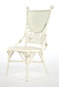 Furniture , AN AMERICAN PAINTED WICKER LADY'S RECEPTION CHAIR IN THE MANNER OF HEYWOOD BROTHERS & WAKEFIELD COMPANY . Circa 1900. 37 x 2...