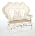 Furniture , AN AMERICAN PAINTED WICKER SETTEE IN THE MANNER OF HEYWOOD BROTHERS & WAKEFIELD COMPANY . Circa 1900. 50-1/2 x 56 x 25 inche...