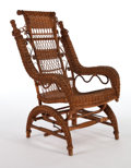 Furniture , AN AMERICAN STAINED WICKER PLATFORM ROCKER IN THE MANNER OF HEYWOOD BROTHERS & WAKEFIELD COMPANY . Circa 1900. 43-1/2 x 26 x...
