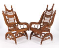 Furniture , A PAIR OF AMERICAN STAINED WICKER PLATFORM ROCKERS IN THE MANNER OF HEYWOOD BROTHERS & WAKEFIELD COMPANY . Circa 1900. 49-1/...