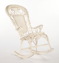 Furniture , AN AMERICAN PAINTED WICKER ROCKING CHAIR IN THE MANNER OF HEYWOOD BROTHERS AND WAKEFIELD COMPANY . Circa 1900. 46 x 22-1/2 x...