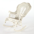 Furniture , AN AMERICAN PAINTED WICKER ROCKING CHAIR IN THE MANNER OF HEYWOOD BROTHERS AND WAKEFIELD COMPANY . Circa 1900. 39-1/2 x 24 x...