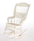 Furniture , AN AMERICAN PAINTED WICKER ROCKING CHAIR IN THE MANNER OF HEYWOOD BROTHERS AND WAKEFIELD COMPANY . Circa 1900. 41 x 25 x 30-...