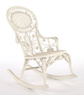 Furniture , AN AMERICAN PAINTED WICKER ROCKING CHAIR IN THE MANNER OF HEYWOOD BROTHERS AND WAKEFIELD COMPANY . Circa 1900. 35 x 22-1/2 x...
