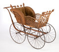 Furniture , AN AMERICAN STAINED WICKER BUGGY IN THE MANNER OF HEYWOOD BROTHERS AND WAKEFIELD COMPANY . Circa 1900. 38-3/4 x 54 x 21 inch...