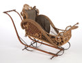 Furniture : American, AN AMERICAN STAINED WICKER BUGGY IN THE MANNER OF HEYWOOD BROTHERSAND WAKEFIELD COMPANY . Circa 1900. 34 x 57 x 22 inches (...