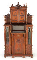 Furniture : American, AN AMERICAN RENAISSANCE REVIVAL GLAZED CARVED MAHOGANY DISPLAYCABINET. Circa 1875. 76 x 40-1/2 x 20 inches (193.0 x 102.9 x...