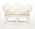Furniture , AN AMERICAN PAINTED WICKER SETTEE IN THE MANNER OF HEYWOOD BROTHERS & WAKEFIELD COMPANY . Circa 1900. 40 x 54-1/2 x 22 inche...