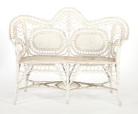 AN AMERICAN PAINTED WICKER SETTEE IN THE MANNER OF HEYWOOD BROTHERS & WAKEFIELD COMPANY Circa 1900 40 x 54-1/2