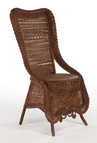 AN AMERICAN STAINED WICKER LADY'S RECEPTION CHAIR IN THE MANNER OF HEYWOOD BROTHERS & WAKEFIELD COMPANY Circa 19...