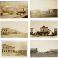 Photography:Official Photos, Six Real Photo Postcards: Fantastic Street Scenes of Logan,Mildred, Ismay, Benchland, and Saltese, Montana, Circa1900-1913.... (Total: 6 Items)