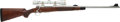 Long Guns:Bolt Action, Custom Engraved Winchester Model 70 Bolt Action Rifle with Leupold Telescopic Sight....