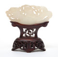 Asian:Chinese, A CHINESE WHITE JADE PLAQUE WITH STAND . 19th century. 1-5/8 incheshigh x 3-1/2 inches wide (4.1 x 8.9 cm) (not including s...