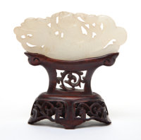 A CHINESE WHITE JADE PLAQUE WITH STAND 19th century 1-5/8 inches high x 3-1/2 inches wide (4.1 x 8.9 cm) (not