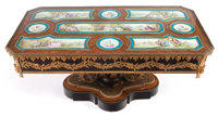 A FRENCH WALNUT, EBONIZED WOOD, GILT BRONZE AND PORCELAIN COFFEE TABLE France, circa 1870 Porcelain signed: